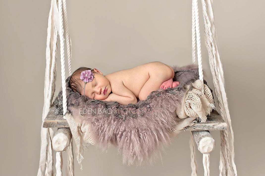 North Vancouver BC Newborn Photographer Eden Bao | Sadie beach swing purple fur flower