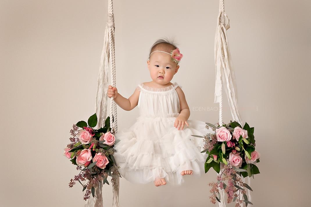 Kirkland baby photographer Ara white dress on swing