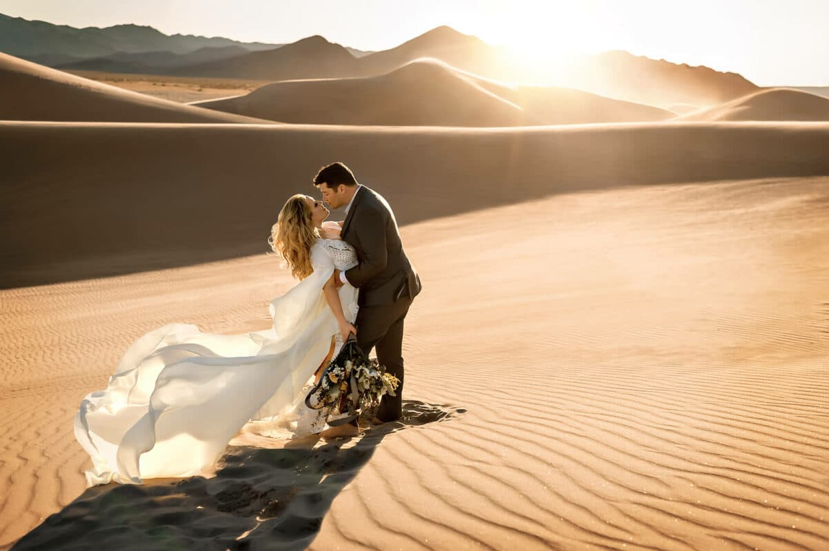 Sand dune couple engagement portrait by Eden Bao